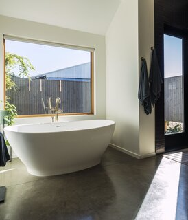 The couple's bathroom features a mineral composite tub from MTI.
