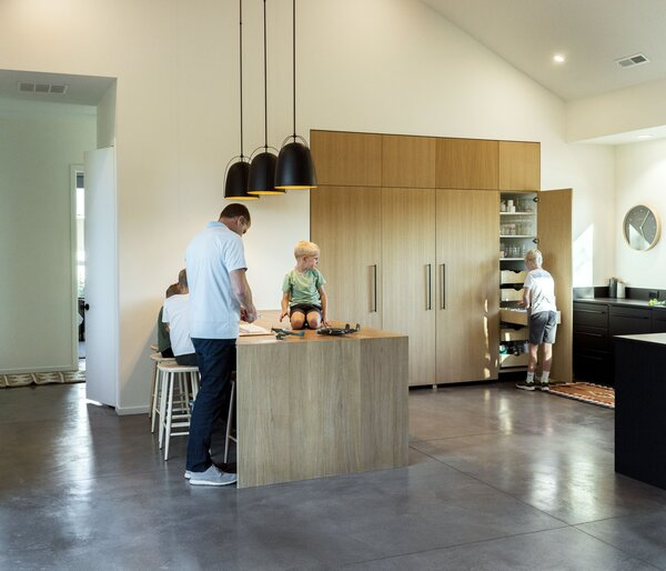 The oak island and cupboards offset the kitchen's black IKEA cabinetry.