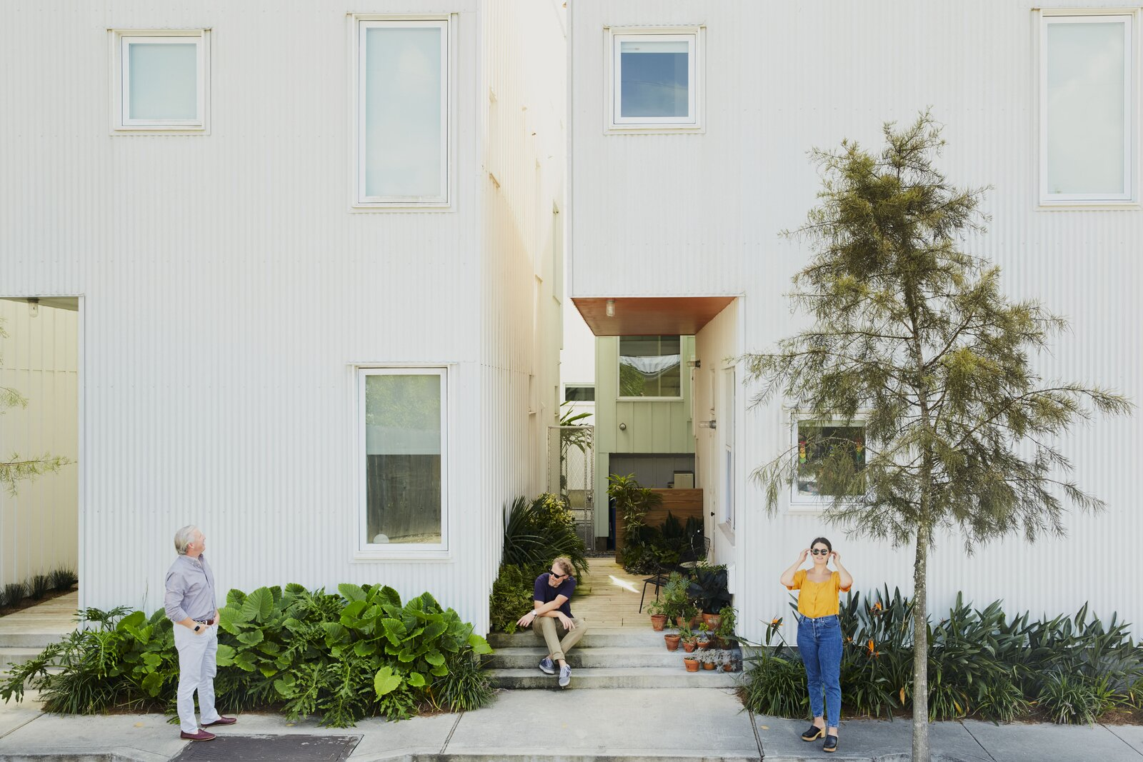 Architect Jonathan Tate (middle) with various residents.  Photo 13 of 14 in How to Build an Affordable America