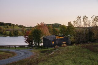 An exterior look at Yanki and Yael Meridan Schori's weekend retreat in Dutchess County, New York, which was designed by their son, Tal Schori of GRT Architects.