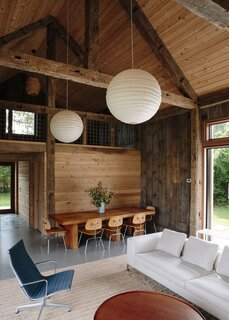 The airy, light-filled interior is made of reclaimed timber and siding from a 19th-century barn.