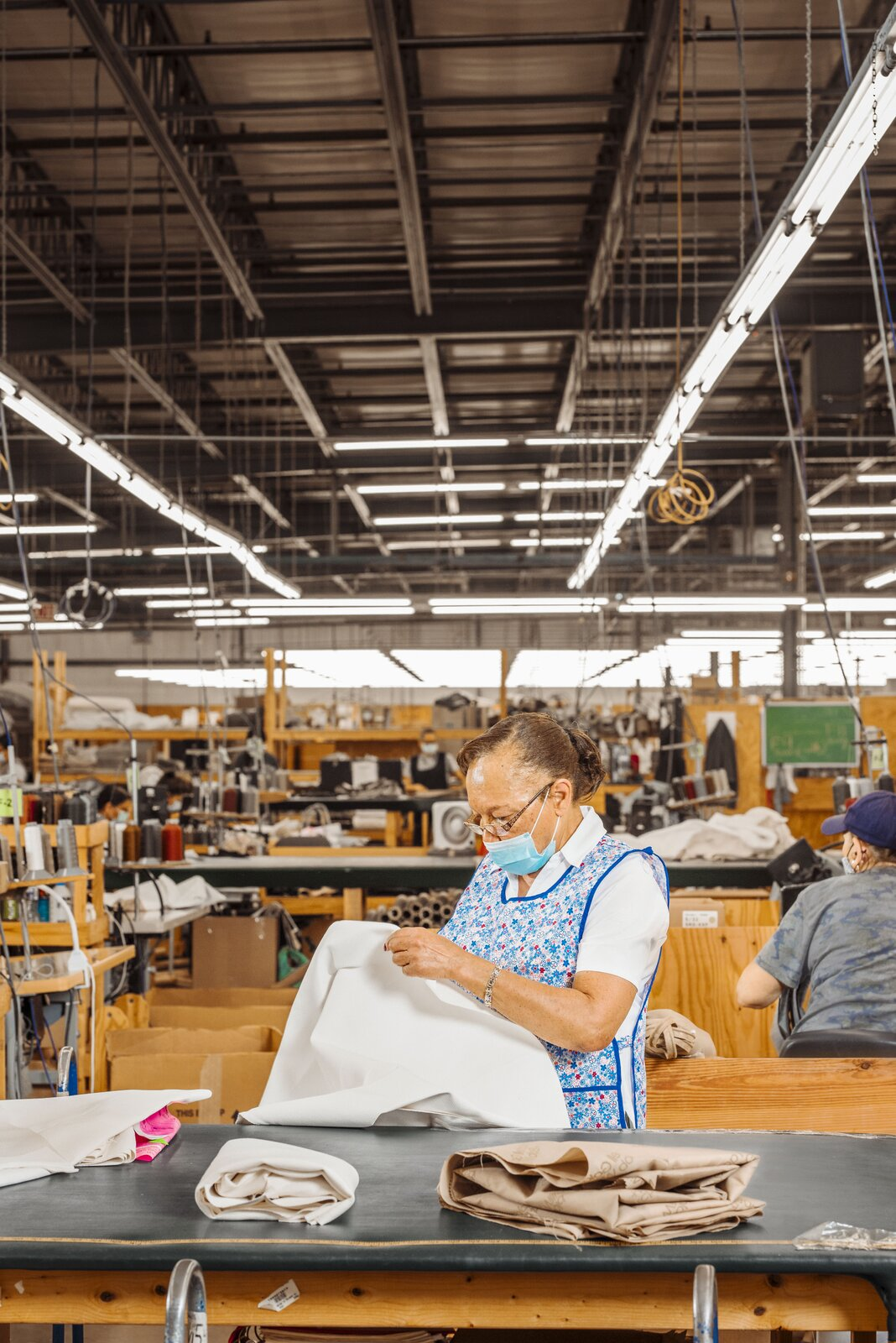 Paulette Jones checks the quality of the sewing and fabric for an Anthony chair at the Mitchell Gold + Bob Williams factory in Taylorsville, North Carolina.