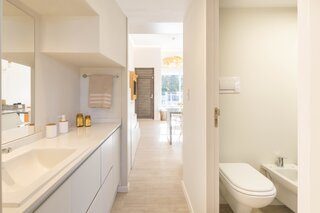 A vanity and bathroom are located between the living area and bedroom.