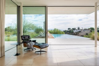 Travertine tile flooring was used inside and outside the Clear Oak Residence to create visual consistency.