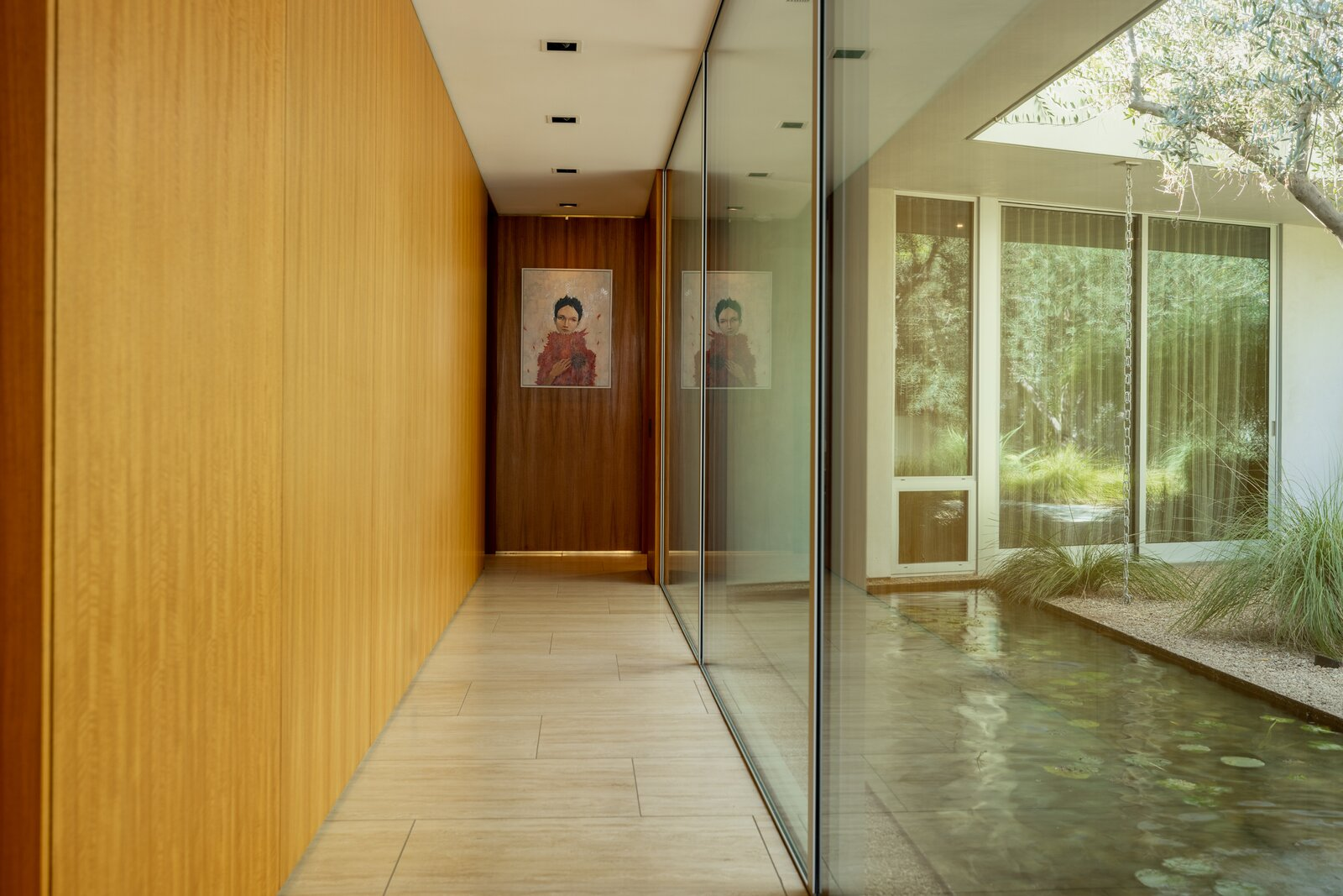 Hallway of Clear Oak Residence by Woods & Dangaran Architects