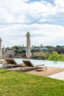 The pool's infinity edge creates the illusion that the home floats above the San Fernando Valley.