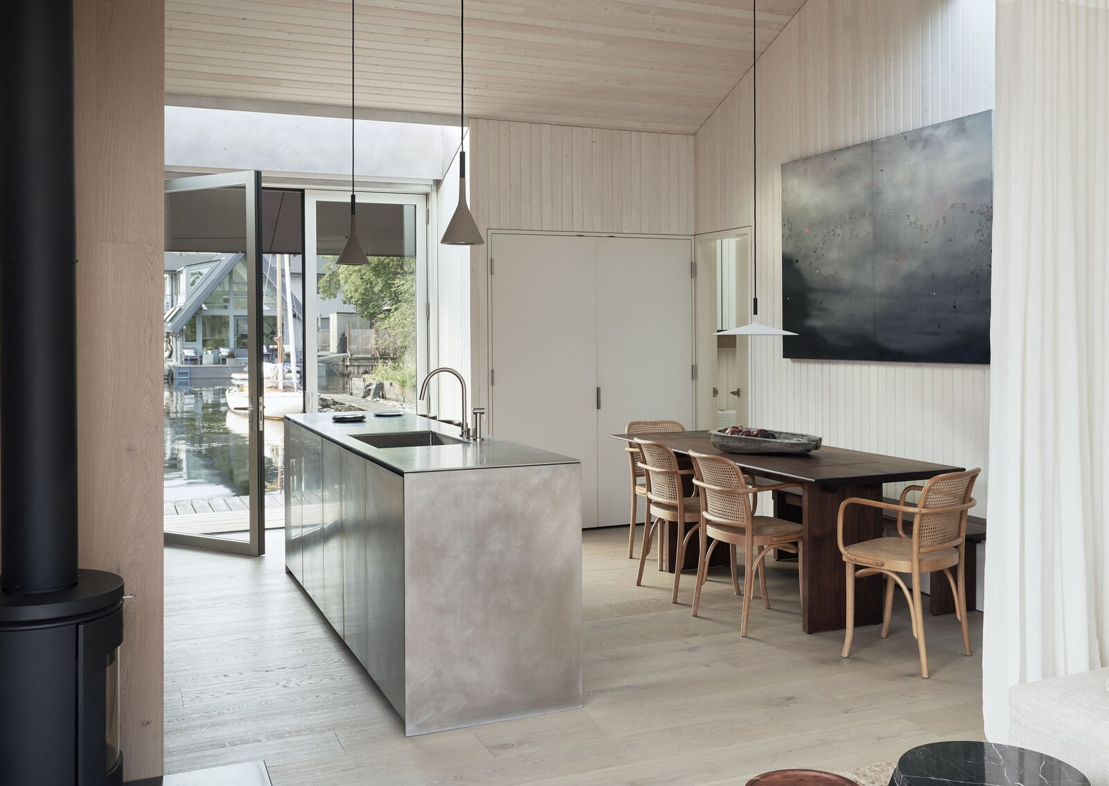 Doors, Swing Door Type, and Interior Photo by Kevin Scott  Photo 1 of 13 in This Breezy Floating Home Makes the Most of a Tranquil Setting Along Seattle's Portage Bay