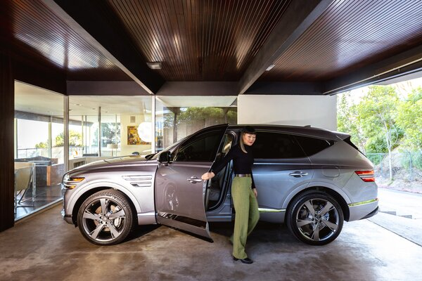 Dwell's executive editor, Jenny Xie, steps out of the Genesis GV80 into Richard Neutra's Lew House.  Preproduction model with optional features shown.