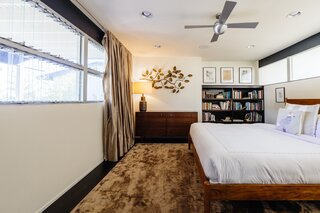 Although the Lew House is over 60 years old, it's been remarkably well preserved. Midcentury modern details like warm colors and platform beds can be found throughout the home.