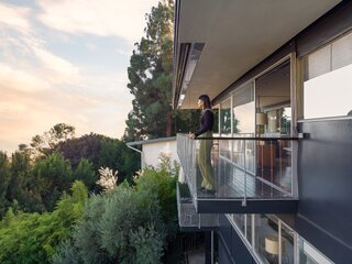 Dwell executive editor Jenny Xie surveys the view from one of the Lew House's balconies.