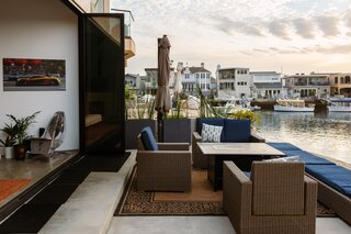 The outdoor deck is an optimal entertainment space that overlooks the Newport Beach marina.