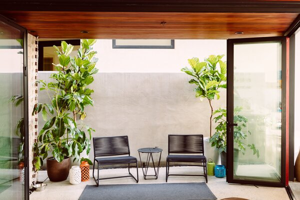 The courtyard off the kitchen is an extension of the living space and a popular spot for morning coffee.