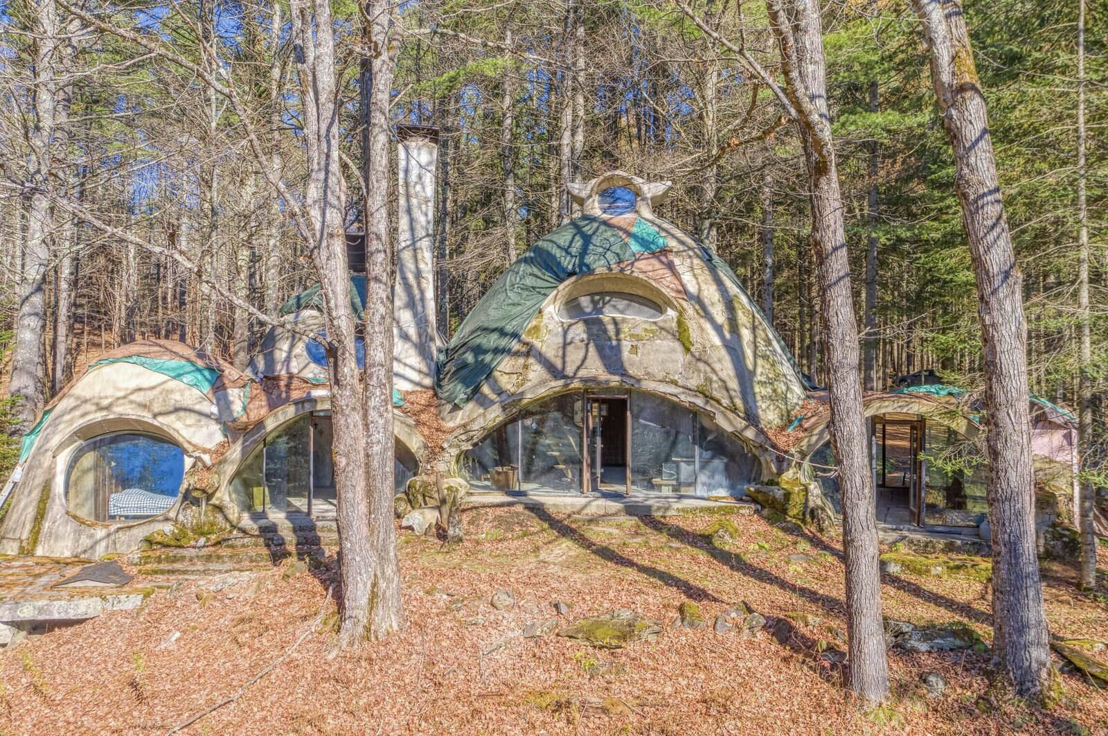 Tarps and temporary fixes are in place to help protect the structure while a buyer is located.  Photo 11 of 12 in Asking $220K, an Architect's Handcrafted Earthen Home Seeks a Visionary Buyer in Vermont