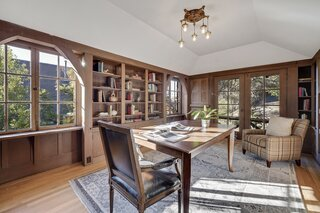 A sunlit library near the entryway was one of several additions designed by Nora Bray's brother, architect John Hudson Thomas.