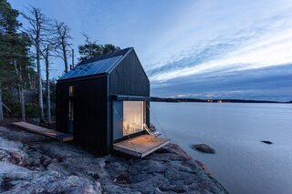 The Majamaja Cabin by Littow Architectes was constructed on-site from prefab wood panels and without the use of heavy machinery. The self-contained unit makes for a perfect eco-retreat, especially when positioned at water's edge in Finland.