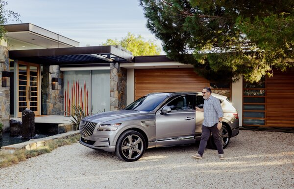 Project designer Wayne Chevalier kept automobile elegance in mind as he remodeled the Malibu Crest residence. Here, he exits a Genesis GV80 parked in front of the garage.  Preproduction model with optional features shown.
