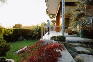 Project designer Wayne Chevalier stands on the patio of the Malibu Crest residence, admiring the impressive view.