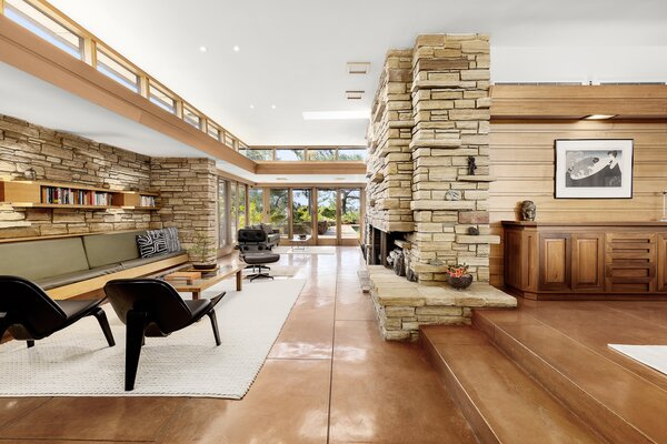 Inside, Wright's influence continues with details such as the central hearth and stone fireplace,