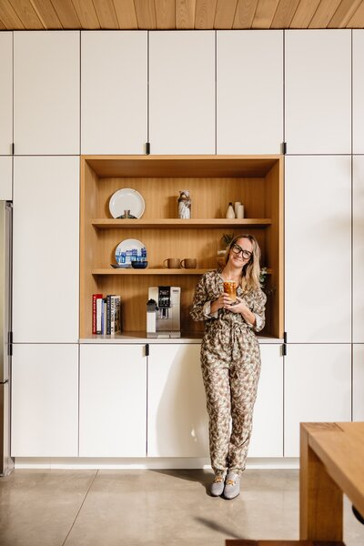 Lalita stands in front of the coffee nook in the couple's kitchen—one of several details that relates to their shared Brazilian heritage. Her childhood was split between São Paulo and Rio de Janeiro, while Fabio grew up in São Paulo before moving to various cities around the world as part of his career in advertising.