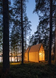 As the sun goes down, the small structure's interior casts a cozy glow.