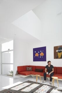 """Moorish-influenced screens veil recessed windows, and clean white walls show off the couple's art collection. """"It's as much a gallery as it is a home,"""" says designer Thomas Bercy."""