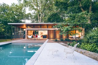 """""""The pitched ceilings and ribbon of clerestory windows make the interior feel more spacious than it is,"""" notes Gooden."""
