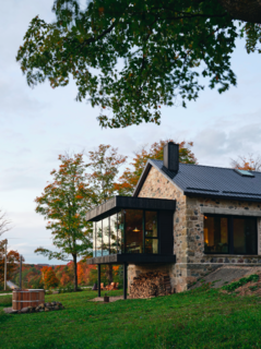 A new cedar and glass dining pavilion extends through the back of a weekend retreat in rural Ontario designed by architect Brian O'Brian for Ben Sykes and Erin Connor. The 19th-century timber and stone structure, formerly a one-room schoolhouse, proved to be the perfect palimpsest for a modern intervention.