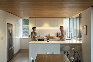 In the kitchen and dining area, chairs from Nood slide under the island and surround a Maraetai table from The Axe.