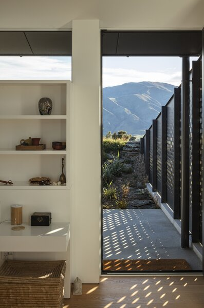 Perforated metal walls protect the patio from the area's intense winds.