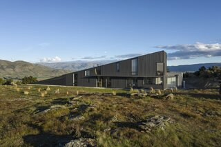 Corrugated steel wraps the South Island home of musicians Justine Cormack and Marc Taddei. The wedge-shaped design, by Nebraska architect Jeffrey Day, was originally intended for Day's mother, who lives in Maine.