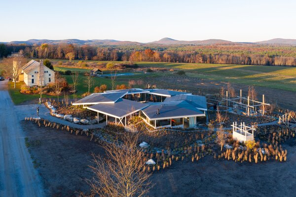 """The result of the project is an artfully arranged house that looks out on open fields (protected by a land trust) and the rolling landscape beyond. """"The only downside is that the area is farmed, so we get manure smells,"""" Doug jokes."""