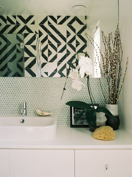 Chris customized the main bathroom's patterned Granada cement tiles. The sink is by Duravit.