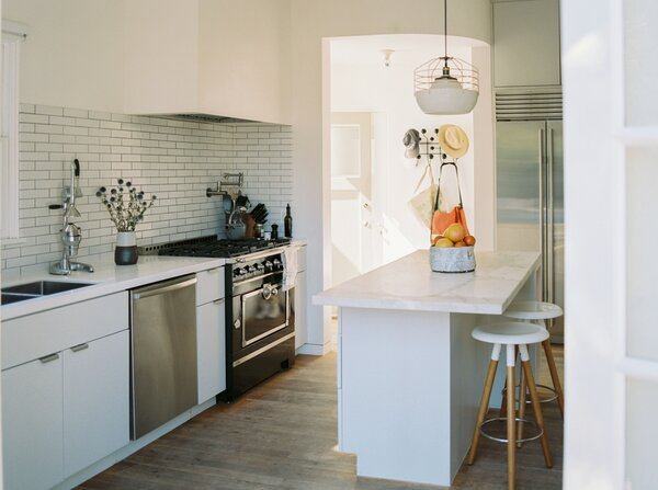 A closer look at the kitchen, which is painted in a crisp white shade by Farrow & Ball.