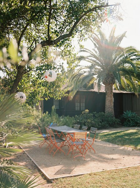 Lush plantings surround one of the two bungalows on the property that the couple converted into art studios.