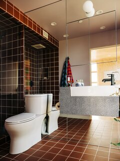 "A look at the principal bathroom. ""A lot of new houses don't feel like they already love their inhabitants. Being able to live in a house that my dad designed is such an amazing, warm feeling,"" Lizz says."