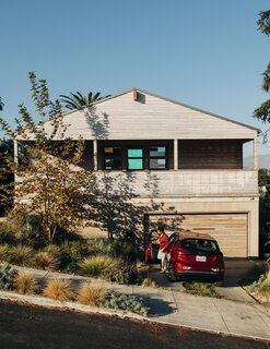 Lizz's parents—Louis, an architect, and Caren, a landscape architect—designed the house, which sits on a steep site.
