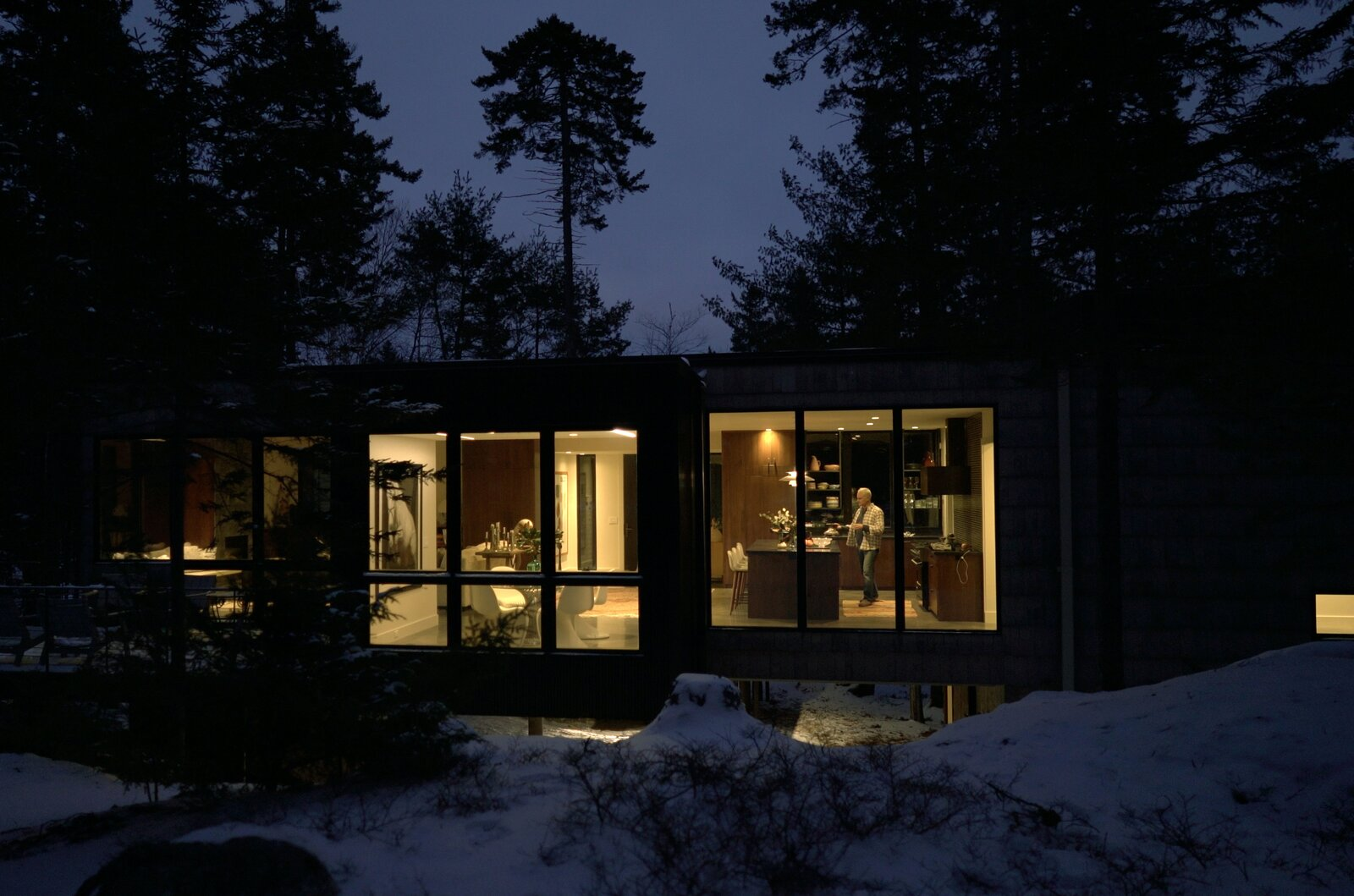 Windows and Picture Window Type A night, the expansive windows and doors allow a warm light to emanate into the isolated forest.  Photo 12 of 12 in A Winding Boardwalk Grounds This Hovering Cabin Along the Edge of a Remote Pond