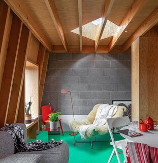 A Gumby-Green Floor Adds Playful Pizzazz to This Rentable Studio in London