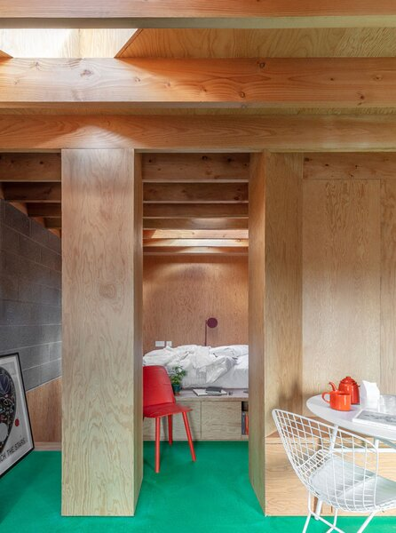 Noiascape Studio designed the various areas in the studio to be separated by bespoke joinery. The wood-lined sleeping area features a custom Kerf Works bed.