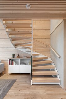 The stairs are comprised of a twisting metal frame and wooden steps.