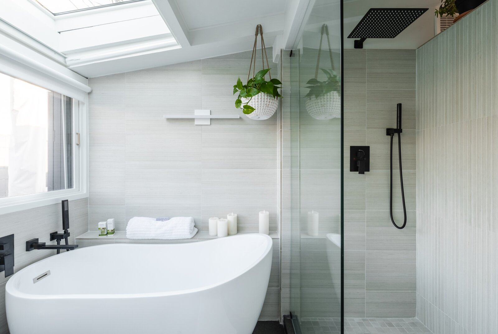 Each of the bathrooms was treated to a top-down renovation with new fixtures and finishes. This one includes a skylight, large glass shower, and oversized tub.  Photo 8 of 12 in A Renovated Cliff May–Designed Home in a Historic SoCal Enclave Asks $1.5M