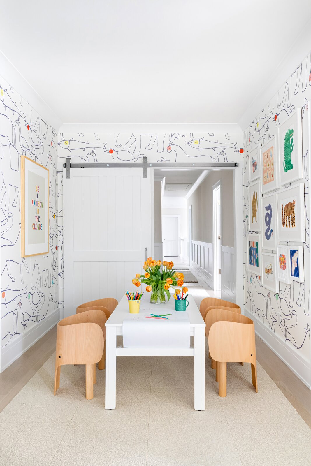 Chango & Co. built a home in Westchester, New York, for a young couple and their newborn baby. Here, the playroom is outfitted with furniture from Finnish Design Shop and Bien Fait wallpaper inspired by childish doodles.  Photo 10 of 13 in How to Design a Room That Grows Up With Your Kids