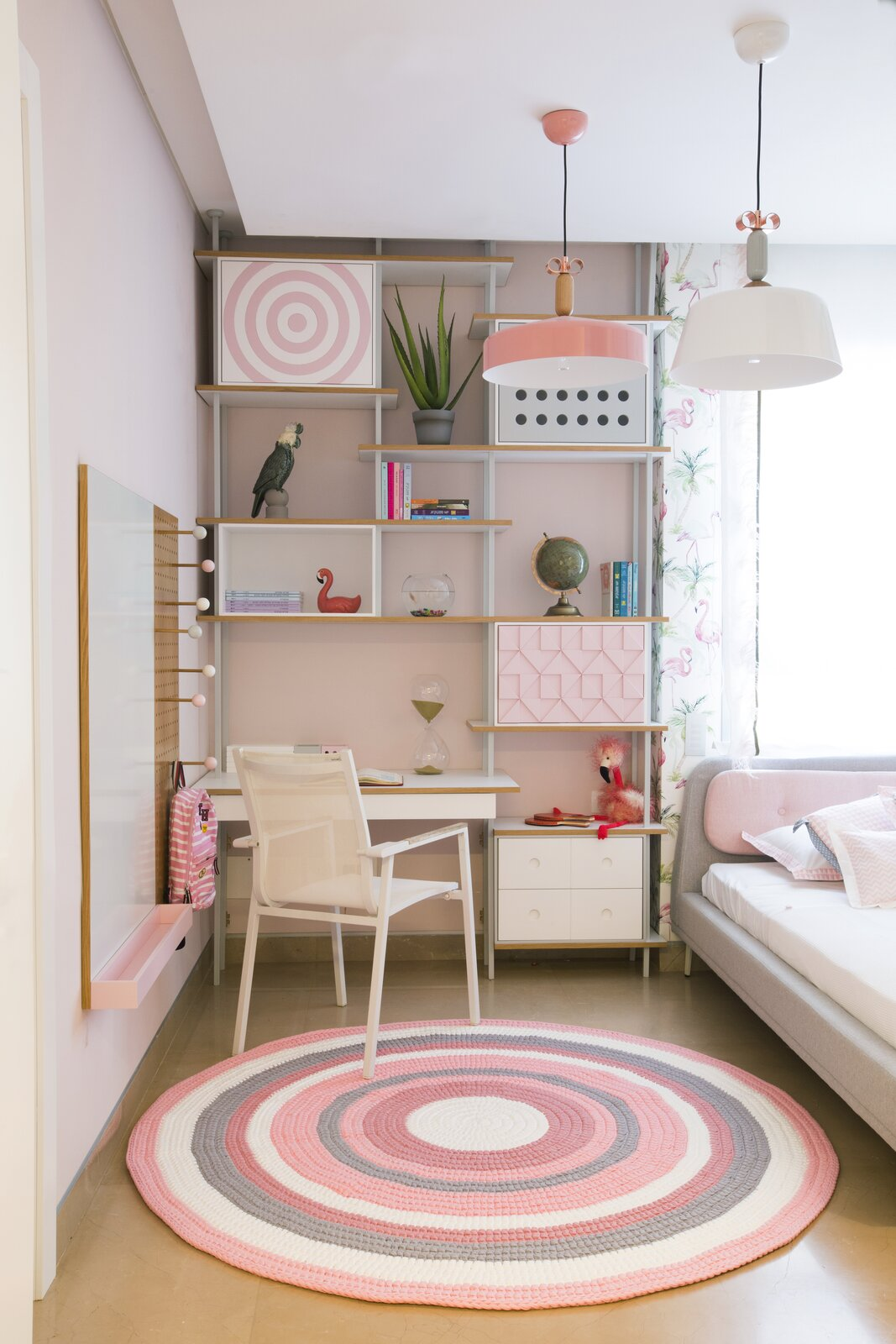 """Hay's """"Blush Room"""" was designed for a 12-year-old girl and offers studying, sleeping, and playing areas. Different materials and textures—wood, metal, wool, fabric—add variety while feeling polished.  Photo 3 of 13 in How to Design a Room That Grows Up With Your Kids"""