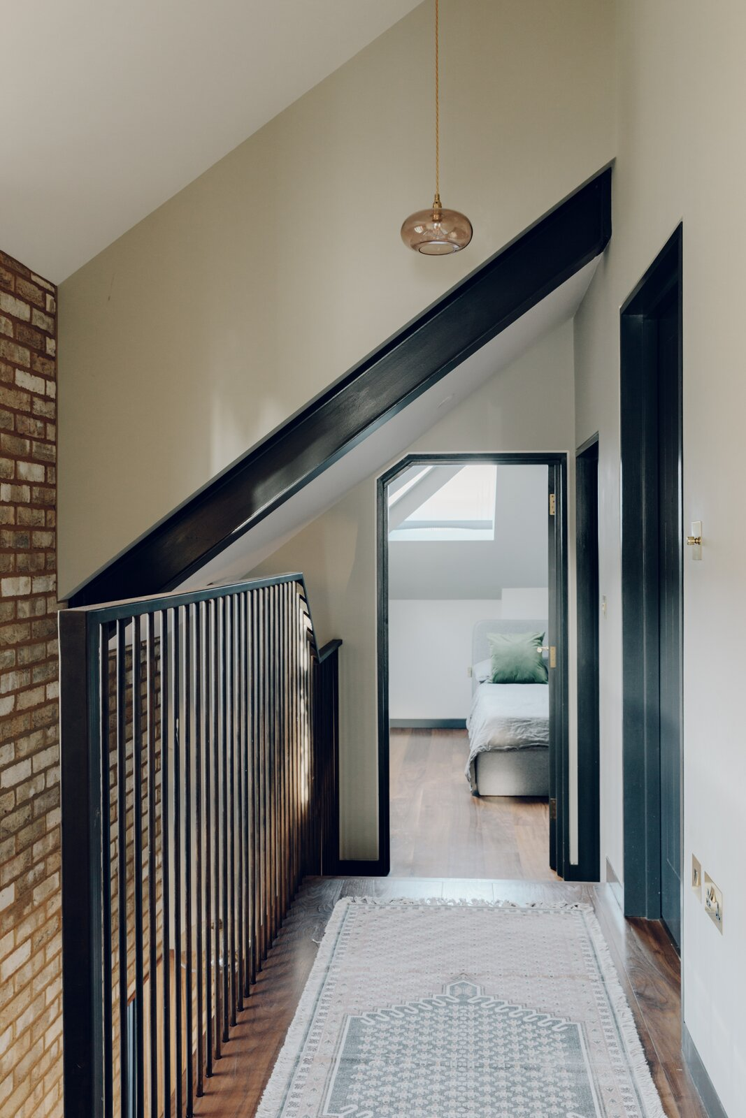 The kitchen stairs lead up to a simple landing, providing access to the remaining three bedrooms. The principal suite is located along the front of the home.  Photo 9 of 13 in An Enchanting, Reimagined Coach House in London Asks £2M