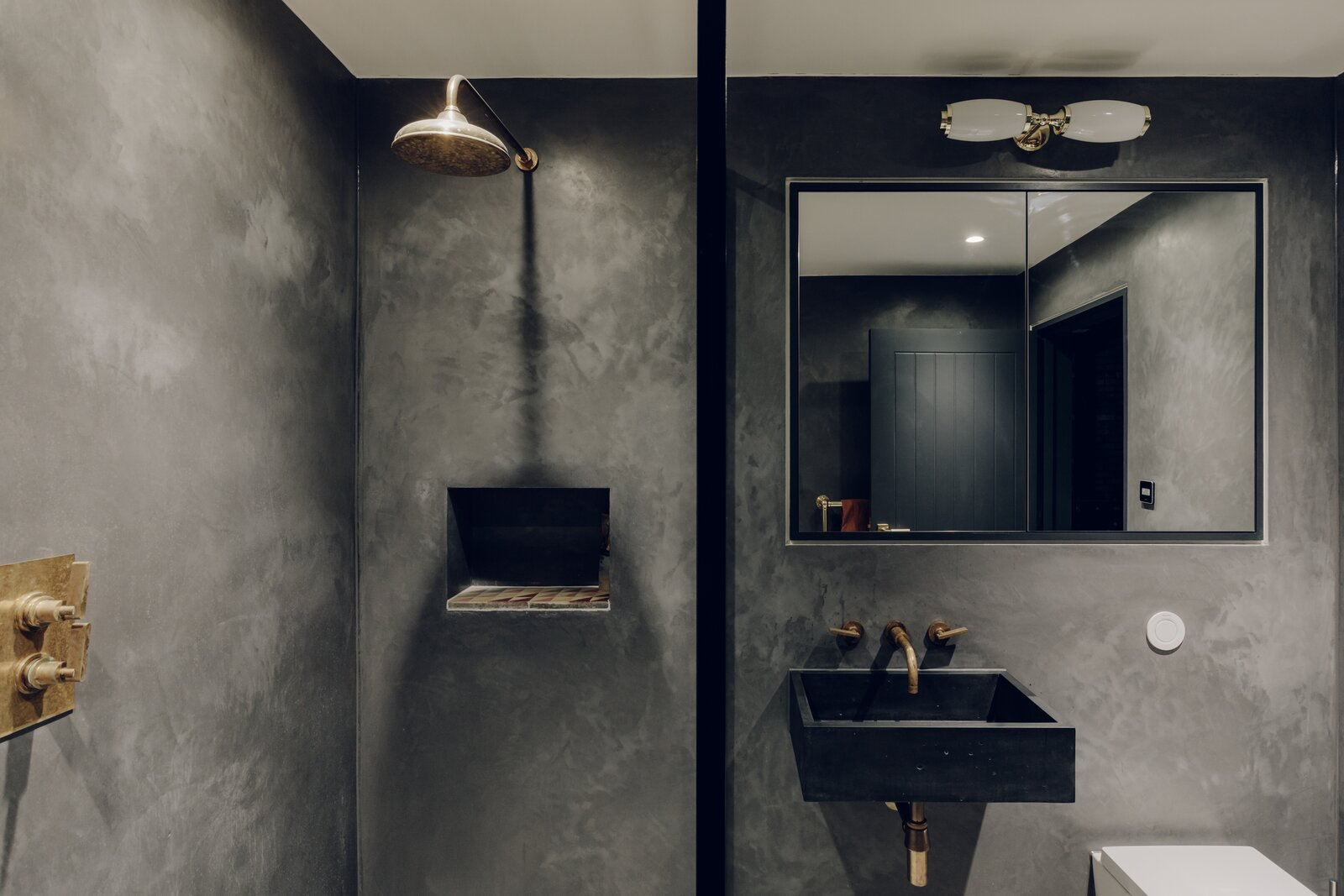 The guest bathroom on the lower level is finished in gray tadelakt.  Photo 8 of 13 in An Enchanting, Reimagined Coach House in London Asks £2M