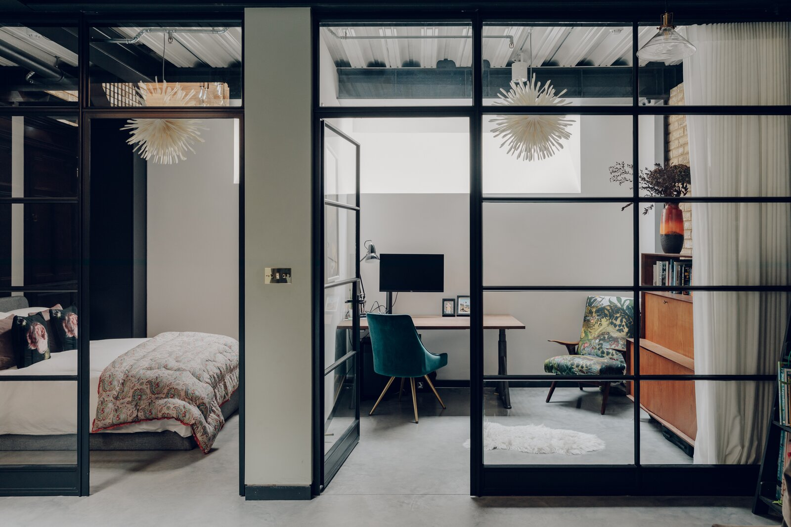 Steel-and-glass walls enclose two other rooms, now set up as a guest room and office.  Photo 7 of 13 in An Enchanting, Reimagined Coach House in London Asks £2M
