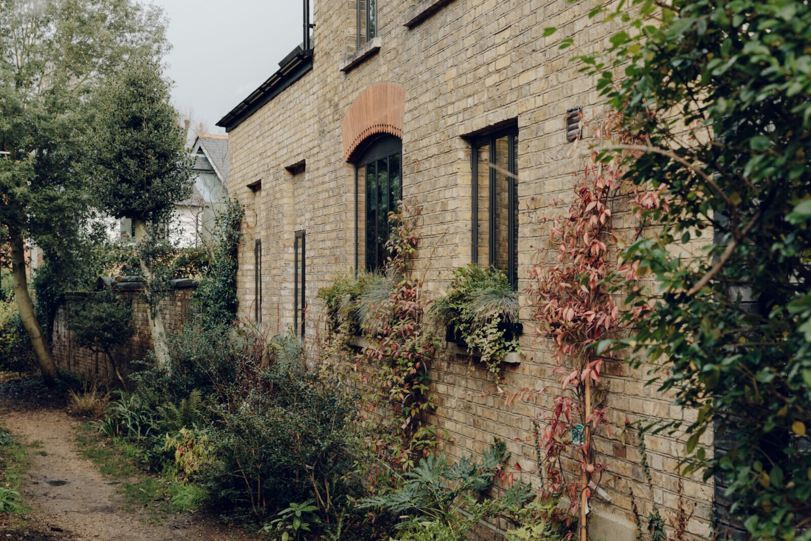 Outside, a path beside the home leads to one of three shared gardens accessible only by residents of the neighboring homes.  Photo 13 of 13 in An Enchanting, Reimagined Coach House in London Asks £2M