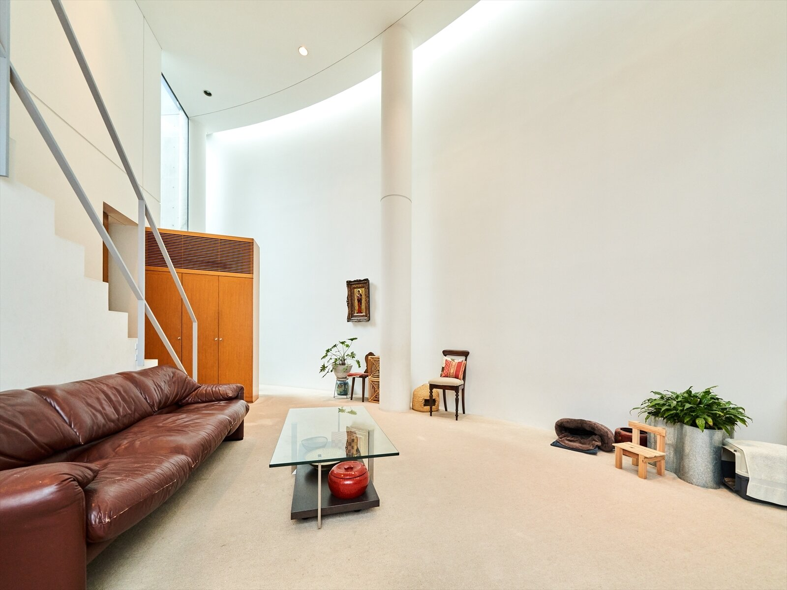 An apartment on the middle floor of Ito House is embraced by the curved wall. Sunlight enters from the sides and above via narrow windows in the courtyard and along the roof.  Photo 4 of 11 in Tadao Ando's Curved Concrete Ito House Asks $7M in Tokyo