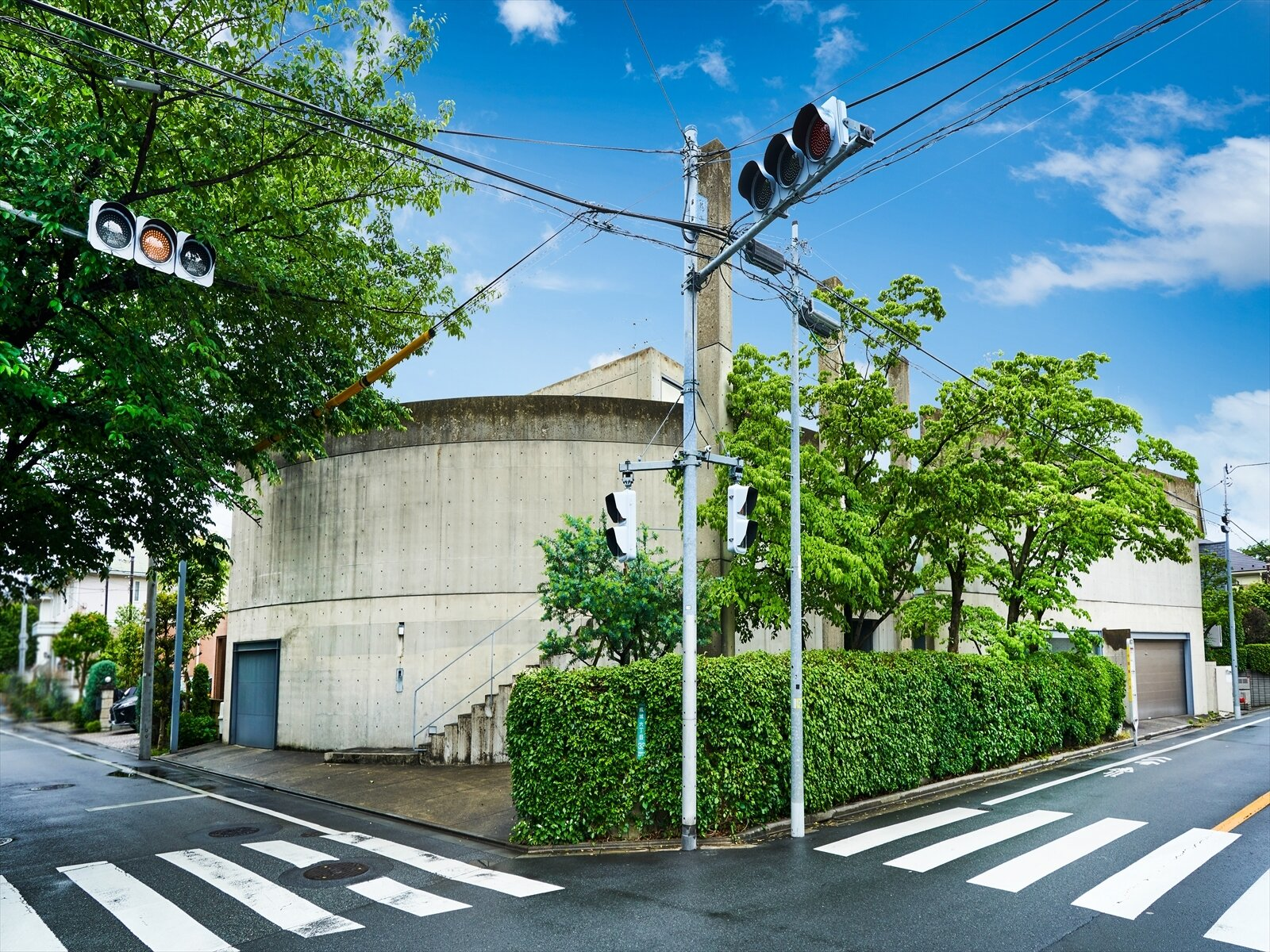 Ito House by renowned Japanese architect and Pritzker Prize winner Tadao Ando hides behind an anonymous, arcing concrete facade in the Setagaya neighborhood of Tokyo, Japan.   Photo 2 of 11 in Tadao Ando's Curved Concrete Ito House Asks $7M in Tokyo