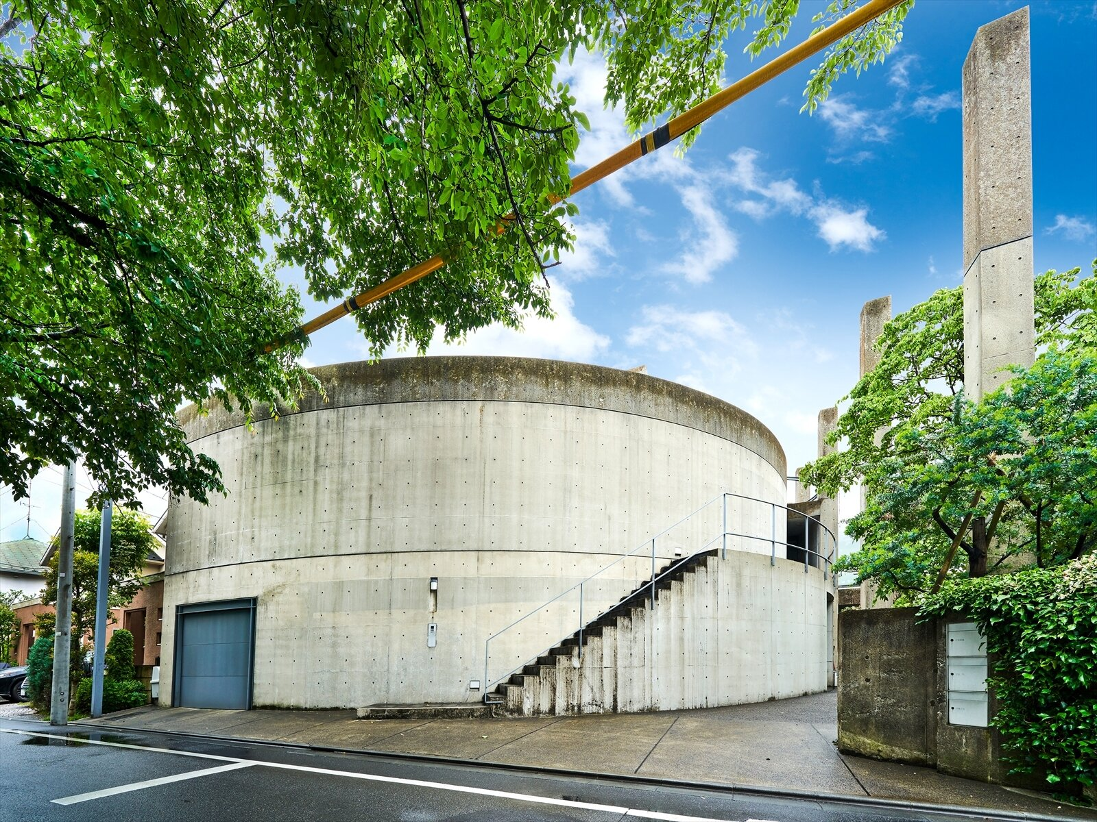 The three-family property by the Pritzker Prize–winning architect features outdoor courtyards protected by the home's arcing facade.  Photo 1 of 11 in Tadao Ando's Curved Concrete Ito House Asks $7M in Tokyo